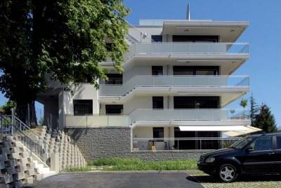 Fenêtres bois et Fenêtres bois-métal - Immeuble Les 4 AS à Lutry